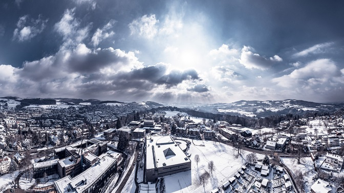 View from above of the University of St.Gallen and the city of St.Gallen
